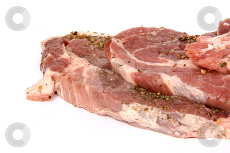Raw pork closeup stock photo, Pork chops with oregano  isolated on white background with copy space by EVANGELOS THOMAIDIS
