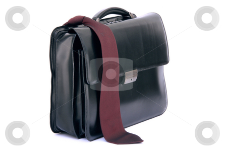Red tie and briefcase stock photo, Red tie on black lether business briefcase isolated on white background by EVANGELOS THOMAIDIS