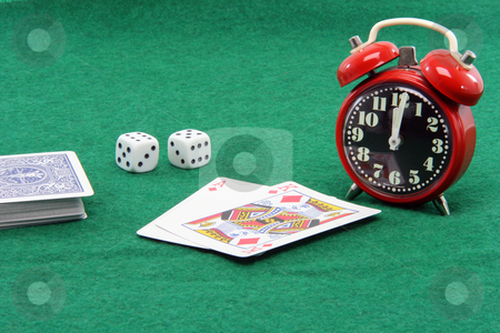 Gambling till twelve stock photo, Gambling concepts playing cards and dices till twelve oclock new year eve by EVANGELOS THOMAIDIS