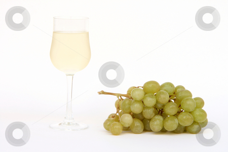 Wine and grapes stock photo, Banch of grapes and glass of white wine isolated on white background by EVANGELOS THOMAIDIS