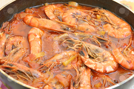 Shrimps in pan stock photo, Shrimps cooked in tomatoe sause mediterranean cuisine by EVANGELOS THOMAIDIS