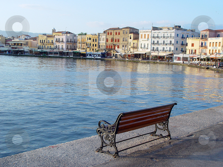 Bench in hania stock photo, Morning view of the venecian port hania kreta greece travel destinations by EVANGELOS THOMAIDIS
