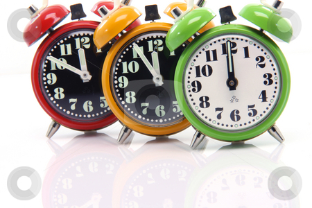 Before twelve stock photo, Timing red yellow and green alarm clock untill twelve oclock closeup by EVANGELOS THOMAIDIS