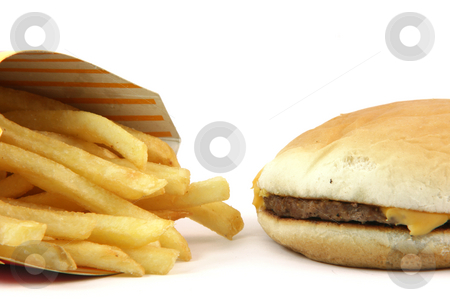 Burger and fries stock photo, French fries and cheeseburger  detail on white backround food concepts by EVANGELOS THOMAIDIS