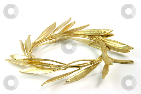 Closeup gold wreath stock photo, Closeup gold winner olive tree wreath for olympic games winners isolated on white background by EVANGELOS THOMAIDIS