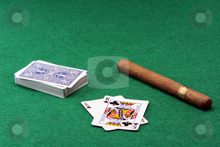 Gabmling and cigar stock photo, Gambling ace with king stack of cards and a large cuban cigar on green felt by EVANGELOS THOMAIDIS