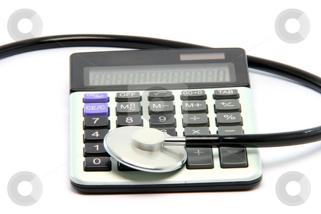 Calculator stethoscope stock photo, Stethoscope on calculator isolated on white background healthcare and finance concepts by EVANGELOS THOMAIDIS