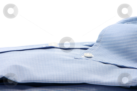 Shirt closeup stock photo, Blue shirt closeup  isolated on white background with copy space fashion and clothing concepts by EVANGELOS THOMAIDIS