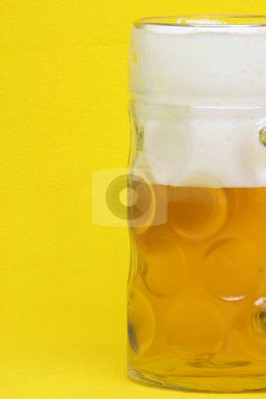 Beer mug on yellow stock photo, Bavarian beer mug detail in yellow background by EVANGELOS THOMAIDIS