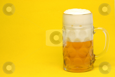 Beer mug with copyspace stock photo, Classic bavarian beer mug in yellow background with copy space by EVANGELOS THOMAIDIS