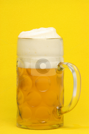 Bavarian beer mug stock photo, Classic bavarian beer mug  in yellow background by EVANGELOS THOMAIDIS