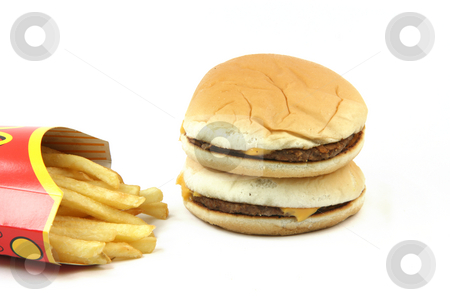 Stack of burgers stock photo, Two cheeseburgers with french fries in box isolated on white backround food concepts by EVANGELOS THOMAIDIS