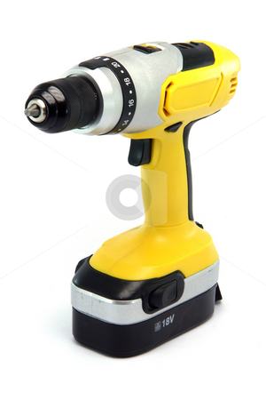 Drill powertools stock photo, Yellow rechargeable drill isolated on white background industrial tools by EVANGELOS THOMAIDIS