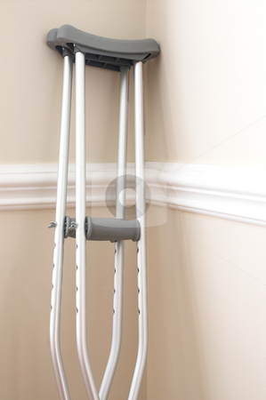 Crutches stock photo, A set of crutches used to aid the walking of injury patients. by Robert Byron