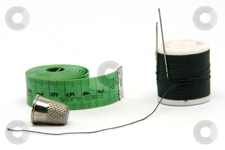 Sewing stock photo, Sewing items measure tape thread and thimble isolated on white background by EVANGELOS THOMAIDIS