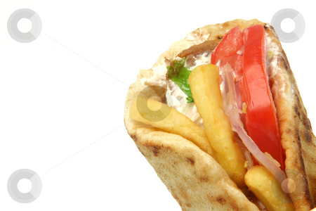 Greek gyros kebap stock photo, Traditional greek food gyros kebap deatil with copy space isolated on white background by EVANGELOS THOMAIDIS