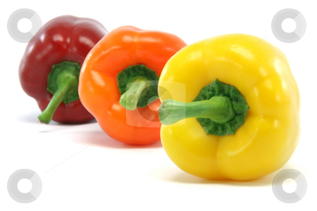 Three peppers stock photo, Clor peppers focus on yellow one closeup isolated on white background food and vegetables concepts by EVANGELOS THOMAIDIS