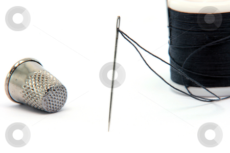 Sewing needle  stock photo, Sewing items needle  thread and thimble isolated on white background by EVANGELOS THOMAIDIS