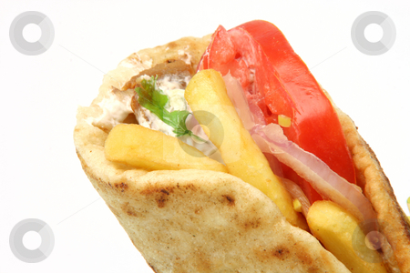 Greek gyros kebap stock photo, Traditional greek food gyros kebap detail isolated on white background by EVANGELOS THOMAIDIS