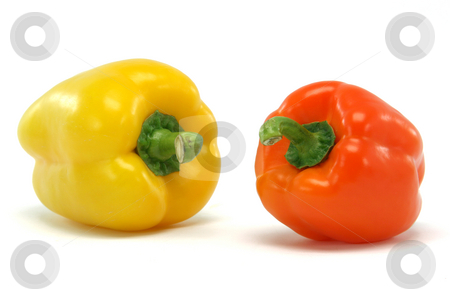 Two peppers stock photo, Yellow and orange color  peppe closeup isolated on white background food and vegetables concepts by EVANGELOS THOMAIDIS