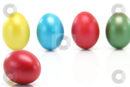 Blur eggs background stock photo, Seasonal concepts bur eggs background isolated on white focus on the front one by EVANGELOS THOMAIDIS