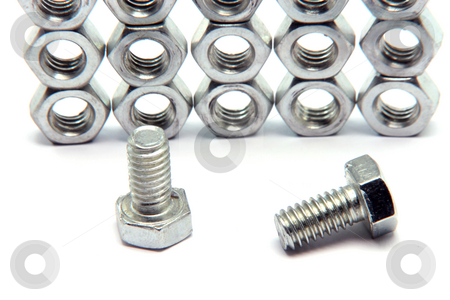 Screws and bolts detail stock photo, Screws and bolts detail isolated on white background with copy space construction industry by EVANGELOS THOMAIDIS