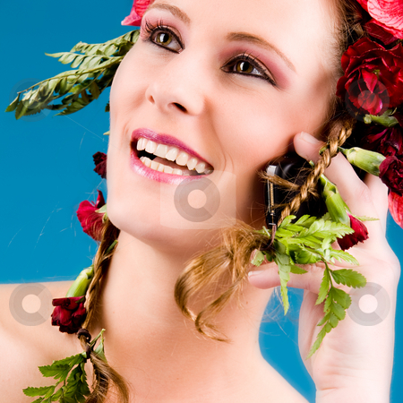 Flowergirl on the phone stock photo, Young woman with big flowers in her hair by Frenk and Danielle Kaufmann