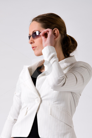 Sturdy girl with sunglasses stock photo, Young sturdy woman with sunglasses on a white background by Frenk and Danielle Kaufmann