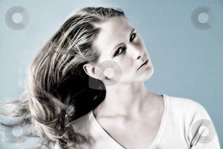 Woman with the wind stock photo, Beauty woman with wind in her hair by Frenk and Danielle Kaufmann
