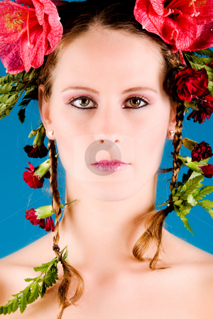 Flower Portrait stock photo, Young woman with big flowers in her hair by Frenk and Danielle Kaufmann