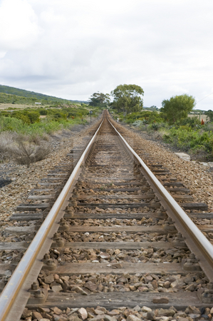 Train track stock photo, A well worn train track running through the countryside. by Nicolaas Traut