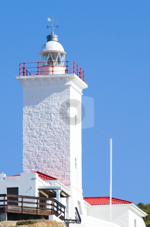 Newly renovated lighthouse stock photo, A newly renovated lighthouse and weatherstation against a bright blue sky. by Nicolaas Traut