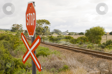 Stop sign for railroad crossing stock photo, A stop sign at a railroad crossing, indicating a single rail to be crossed. by Nicolaas Traut