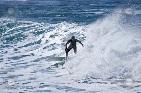 Surfer in the waves stock photo, A surfer in a wave showing perfect style and balance. by Nicolaas Traut
