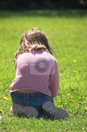 Playing Girl stock photo, A little girl playing in the grass. by Robert Byron
