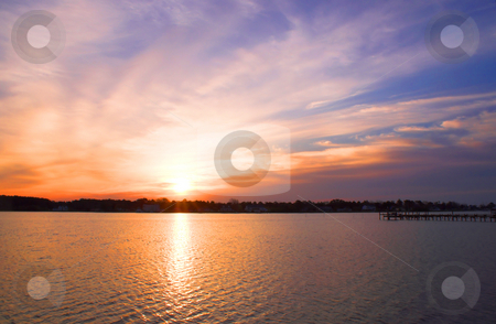 Ocean Sunrise or Sunset stock photo, The sunrise or sunset over a salt water inlet. by Robert Byron