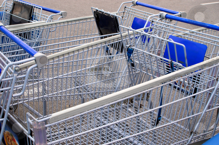 Shopping Carts stock photo, A series of shopping carts at a retail store. by Robert Byron