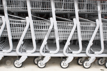 Shopping Carts stock photo, A series of shopping carts at a retail store. by Robert Byron