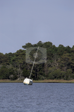 Sailboat stock photo, A sailboat moored in a body of water. by Robert Byron