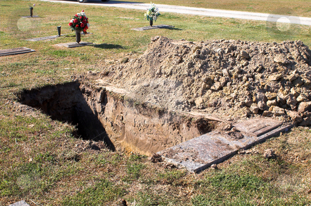 Grave stock photo, An open grave at a graveyard. by Robert Byron