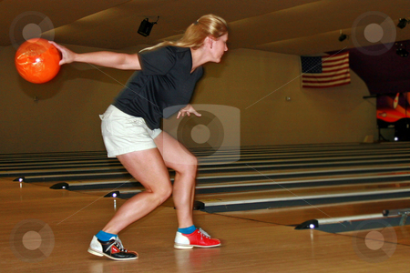 Ready to Bowl stock photo, Jane ready to throw the ball down the bowling lane. by Lucy Clark