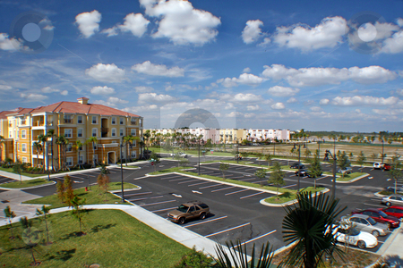 Florida View stock photo, View over car park and colorful buildings. by Lucy Clark