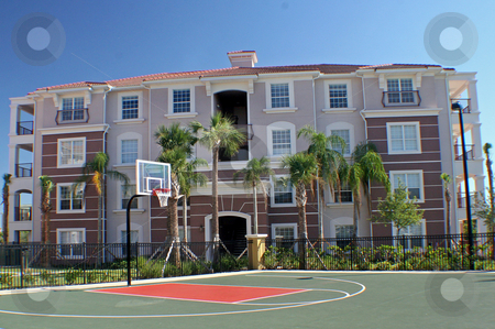 Building and Court stock photo, Colorful building behind basketball court in Florida. by Lucy Clark