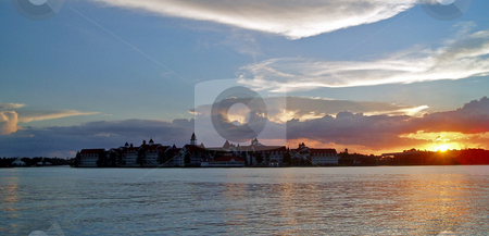 Sunset, lake and buildings stock photo, Buildings with a lake and a beautiful sunset. by Lucy Clark