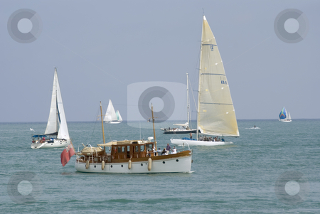 Old yatch stock photo, Old motor boat and modern sailing boat. by Serge VILLA