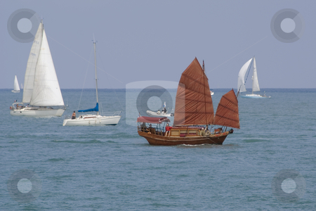 Junk stock photo, Brown junk during a regatta. by Serge VILLA