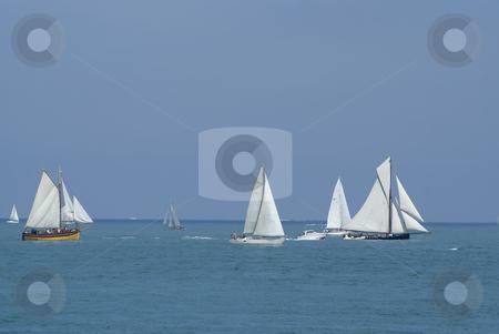 Sailing boat stock photo, Several sailing boats during a regatta. by Serge VILLA