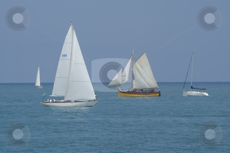 Regatta stock photo, Two generation of sailing boats. by Serge VILLA