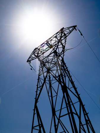 Electricity power stock photo, High voltage electricity pylon with bright summer sun by Laurent Dambies