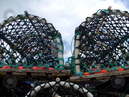 Lobster pots stock photo, Details of lobster pots in harbor. by Martin Crowdy